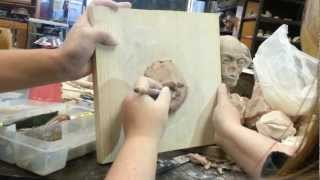 Sculpting a mouth in clay
