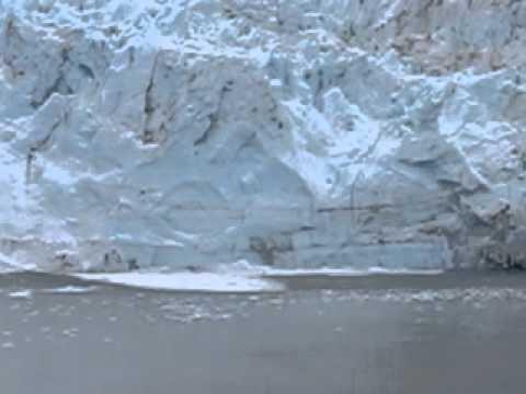 glacier falling into ocean