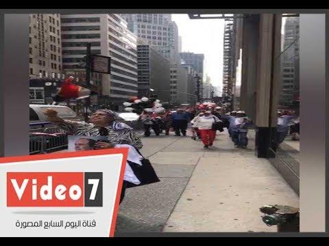 الجالية المصرية بنيويورك ترفع صور الرئيس وشيخ الأزهر والبابا تواضروس