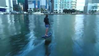 Battery powered hydrofoil surfboard floats above water