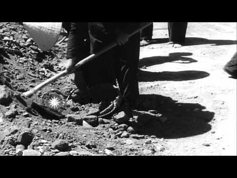 Vietnamese women work on highway construction in Vietnam. HD Stock Footage
