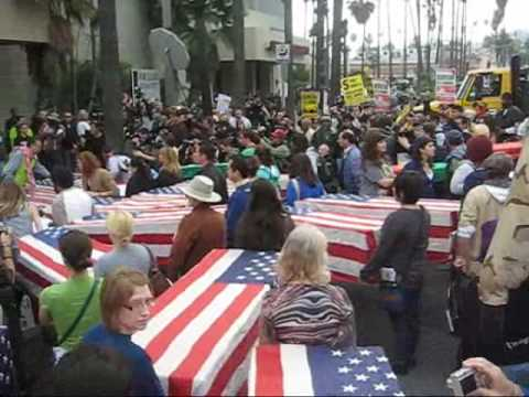 Anti-War March Ron Kovic presents Coffins to Recruitment Center Hollywood