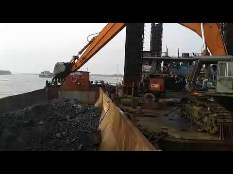 Tata Hitachi EX 600 excavator on Barge Dharamtar Video 1 on rental basis JSW site India Bardai