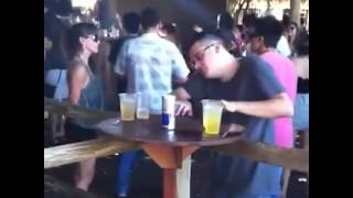 Guy thinks he's a DJ and the table is his decks lol - only in Ibiza....