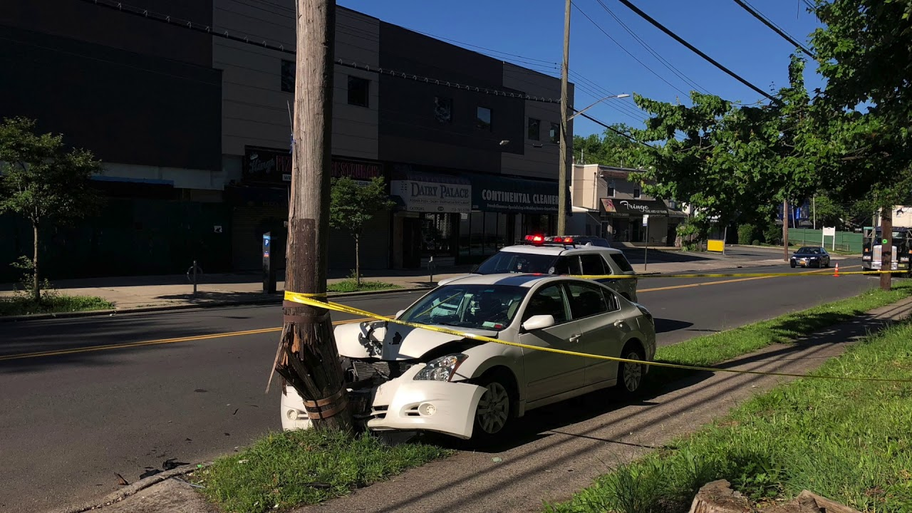 Wires spark after a car hits utility pole