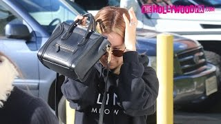 Ashley Tisdale Leaves The Gym And Covers Her Face To Go Shopping - The HollywoodFix.com