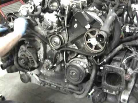 Alternator belt tensioner assembly