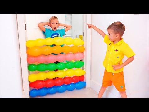Vlad and Nikita kids play with balloons