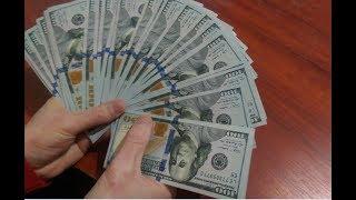 Як перевірити 100 доларів США нового зразка