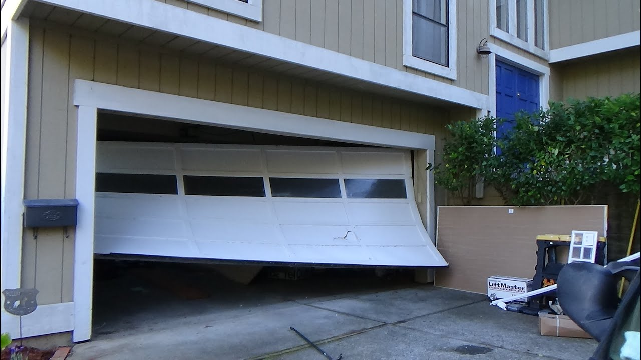 R Amp R Sectional Garage Door Hit By A Car Youtube