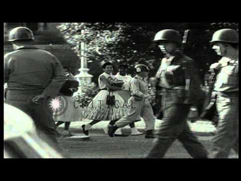 US soldiers escort African American students from Little Rock Central High School...HD Stock Footage