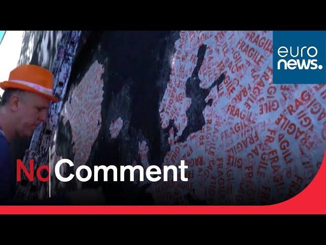 Coronavirus: Artist in Paris highlights pandemic plight with 'fragile' world map