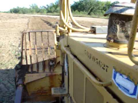 Cat D7H dozer pushing dirt