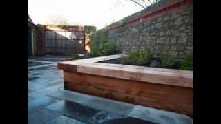 These raised beds double as benches for sitting or working on. The benches are wide enough to sit on and to place a plate by your