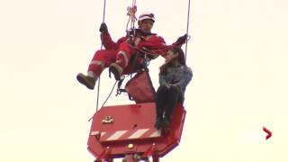 Woman rescued from crane in Toronto arrested for mischief