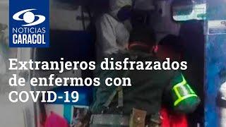 Extranjeros disfrazados de enfermos con COVID-19, sorprendidos en una ambulancia