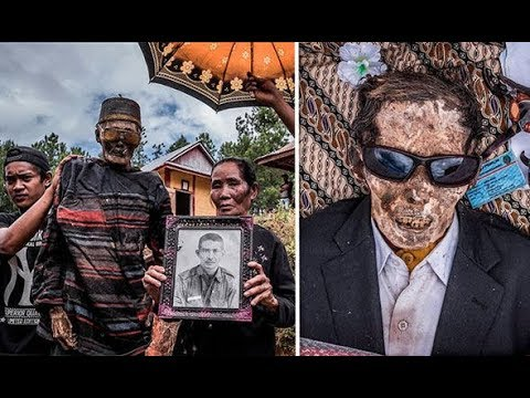 THE MUMMIES RETURN Ritual of dressing up d ead relatives revealed in shocking images