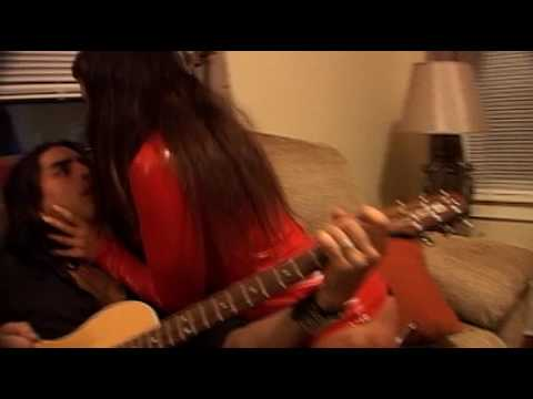 Girl having sex with a guitar