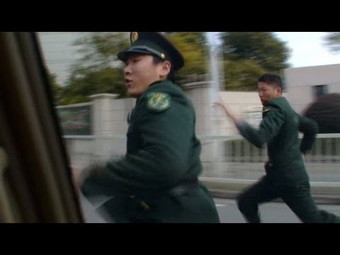 China security officers chase CNN crew