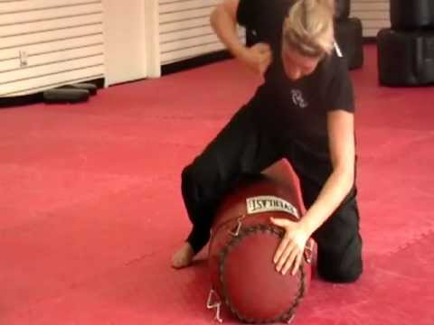 Image result for woman pounding punching bag