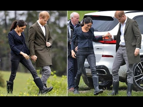 Meghan Markle walks through a field in very stylish boots as she and Prince Harry arrive in Auckland
