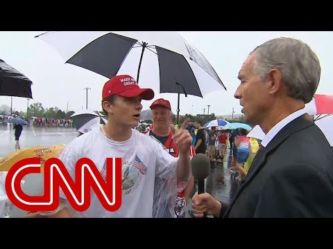 CNN reporter talks to conspiracy theorists at Trump rally