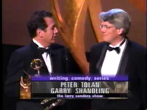 Garry Shandling receiving an award at 1998 Emmy Awards