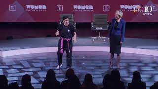 Lina Khalifeh teaches the audience a battlecry at the 2019 WITW Summit
