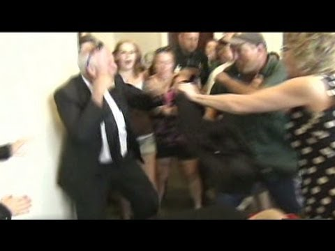 Watch fists fly during courthouse brawl