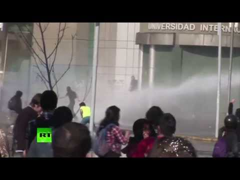 Video: Violent clashes as 100,000-student protest turns ugly in Chile