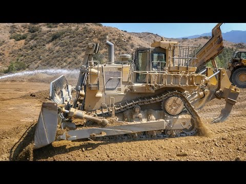 Big Cat D10T Dozer Pushing Out 777 Loads.