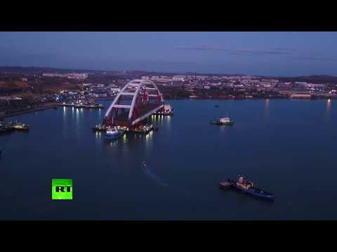 AERIAL: 5,500-ton Crimea Bridge motorway arch sails off for installation op