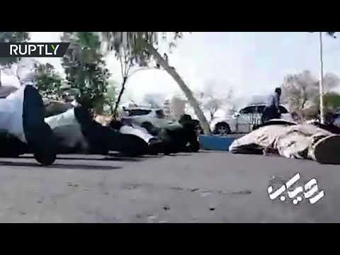 DISTURBING: Moment Iranian Army parade is attacked by gunmen