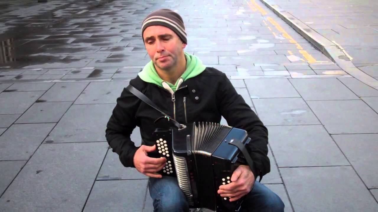 Busking Accordion Player Playing Scottish Music In Glasgow Scotland