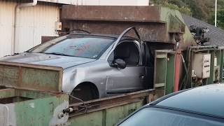 car-crusher-crushing-cars