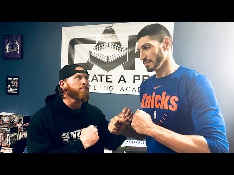 Curt Hawkins battles New York Knicks Center Enes Kanter in impromptu match