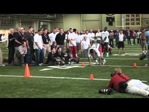 Reggie Ragland runs through a drill at Alabama