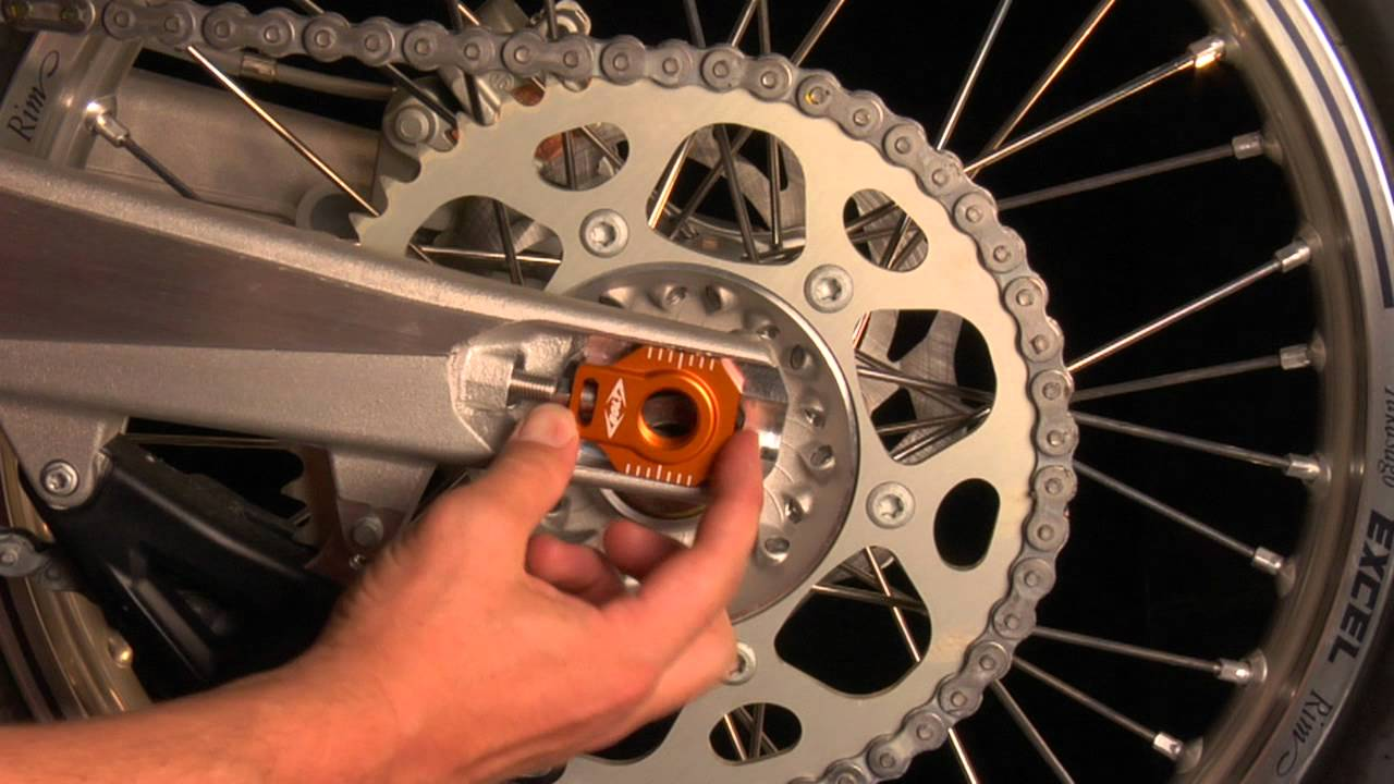 How to install Bolt's Chain Adjuster Blocks on a KTM - YouTube