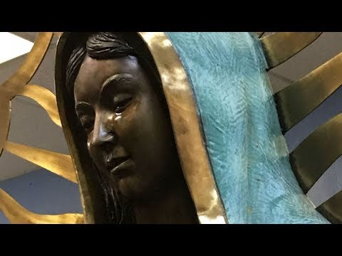 Why is this statue of the Virgin Mary weeping rose-scented olive oil? HD
