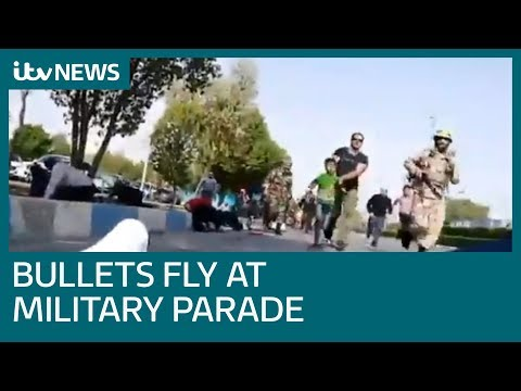 Iranian military parade attacked by gunmen | ITV News