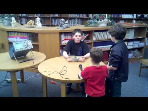 Max explaining sound waves at Northpoint Elementary School