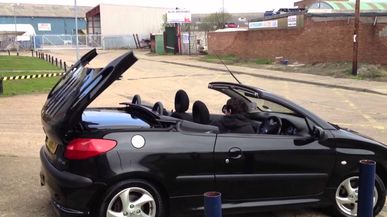 peugeot 206 cc taking down the roof youtube. Black Bedroom Furniture Sets. Home Design Ideas