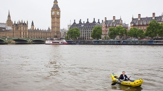 Commuter Kayaks On Thames To Work