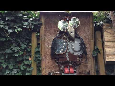 Junk garden art. Metal scrap owl with insulators