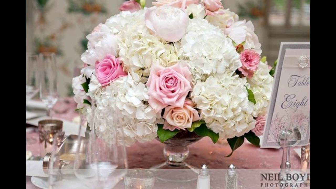 white hydrangea and pink rose centerpieces