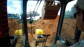 Excavators Backfilling and Compacting Pipe