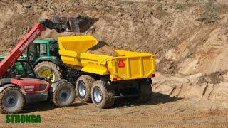 Stronga DumpLoada DL1000HP Half Pipe trailer with a John Deere tractor