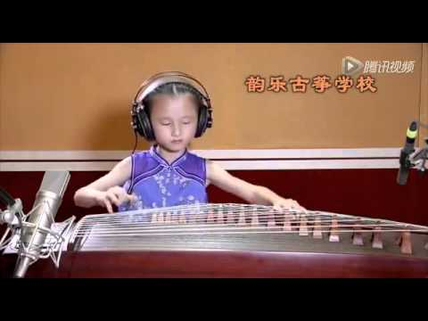 Chinese Kid of age 5+ playing Koto instrument