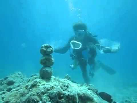 Diver Uses Water Pulse To Knock Down Rocks