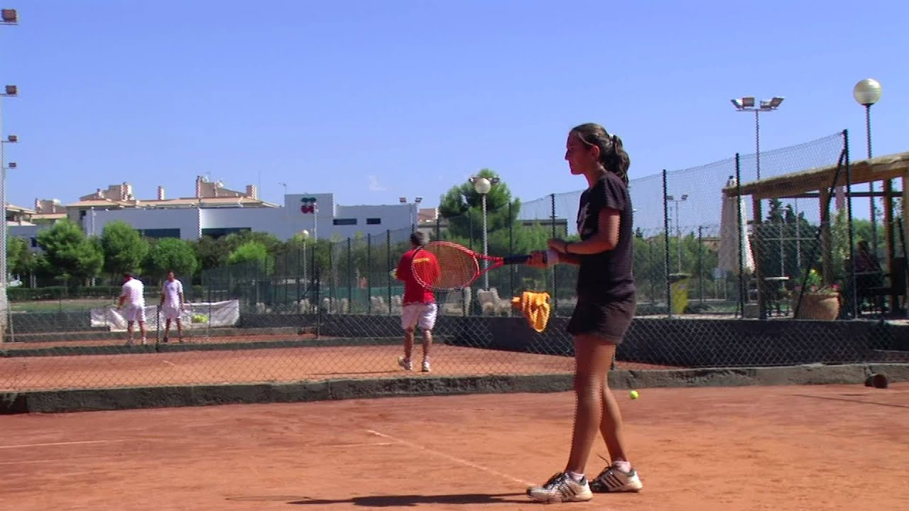 Junior players training at Guillermo Vilas Tennis Academy Mallorca